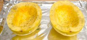 Now just turn the squash face down and bake in the oven!